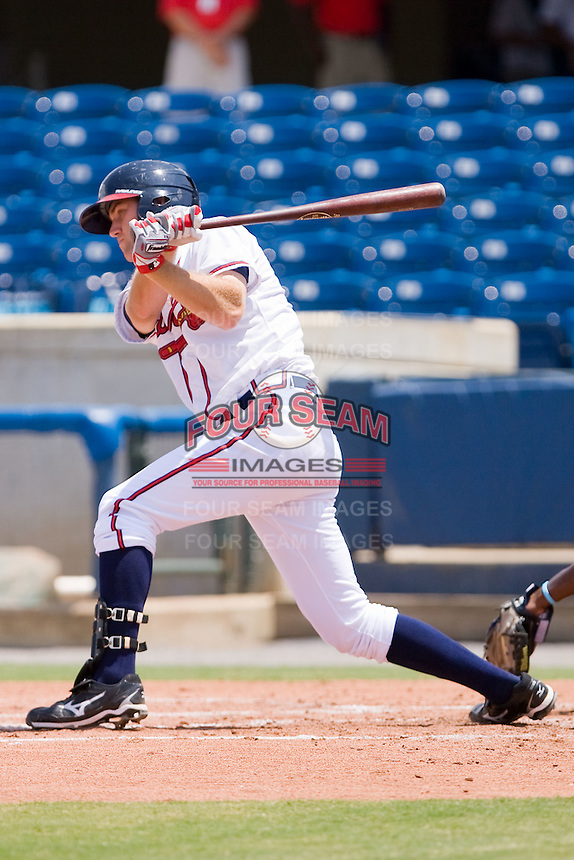 Joe Leonard #39 of the Rome Braves follows through on his swing against the Greenville Drive at State Mutual Stadium July 25, 2010, in Rome, Georgia.  Photo by Brian Westerholt / Four Seam Images