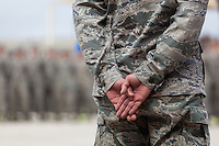 Airman at Lackland Air Force Base, San Antonio, Texas standing at parade rest during basic training graduation exercises.