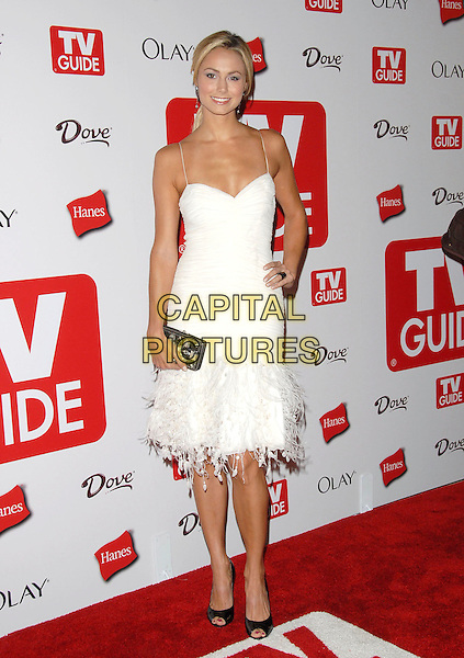 STACY KEIBLER.The 4th Annual TV Guide Post Emmy Party held at Social in Hollywood, California, USA..August 27th, 2006.Ref: DVS.full length white dress hand on hip feathers.www.capitalpictures.com.sales@capitalpictures.com.©Debbie VanStory/Capital Pictures