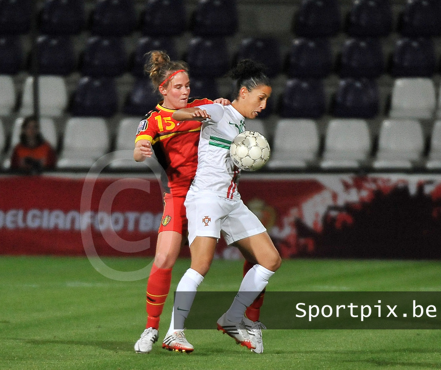 20131031 - ANTWERPEN , BELGIUM : Belgian Marlies Verbruggen (15) pictured with Portugese Claudia Neto (right) during the female soccer match between Belgium and Portugal , on the fourth matchday in group 5 of the UEFA qualifying round to the FIFA Women World Cup in Canada 2015 at Het Kiel stadium , Antwerp . Thursday 31st October 2013. PHOTO DAVID CATRY