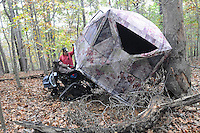 NWA Democrat-Gazette/FLIP PUTTHOFF <br /> Steve and Jackie Swope show Oct. 26 2016 how Steve gets into his hunting blind after Jackie raises the lightweight, portable blind.