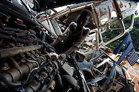 a child works on a car engine at an open air mechanic shop in a very poor neighborhood in Bissau, Guinea Bissau on Monday Sept 17 2007.///..Guinea Bissau is infamous for its cocaine trafficking. in 2005 Colombian cartels begun to arrive in the country transforming it into a Narco State. Up to 5 tons of pure cocaine are estimated to be arriving in the country every week. Guinea Bissau is the 5th poorest country in the world, making it the ideal transit base for the cocaine that will finish on the european markets. Corruption and involvement in the trafficking are present at every level of its institutions..Guinea Bissau is only one of the countries in West Africa involved in cocaine trafficking. Tons of Cocaine have been seized in Nigeria, Senegal, Ghana and  Sierra Leone.