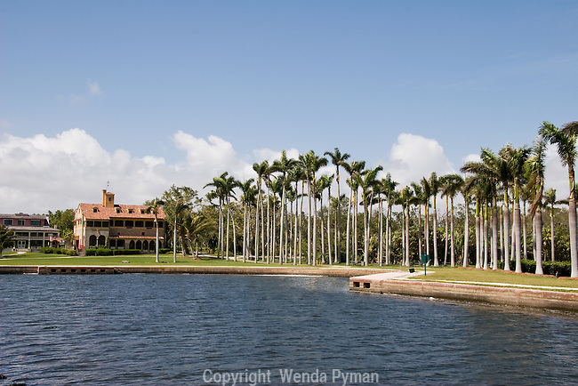 View of the Deering mansion from the boat run around lined with Royal palms.