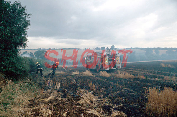 Firefighters attacking a field fire. The fire has spread from the field to the hedge, it is imperative that this is stopped otherwise the fire will spread from one field to another. This image may only be used to portray the subject in a positive manner..©shoutpictures.com..john@shoutpictures.com