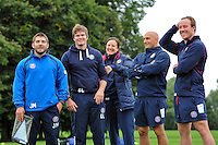 Strength and Conditioning coaches Jameson Mola, Guy Lewis, Matt Pickard and Mark Atkinson and Physiotherapist Jane West have a laugh. Bath Rugby training session on September 23, 2013 at Farleigh House in Bath, England. Photo by: Patrick Khachfe/Onside Images