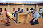 Kenyan Woman & Barrie Callow Building Solar Oven