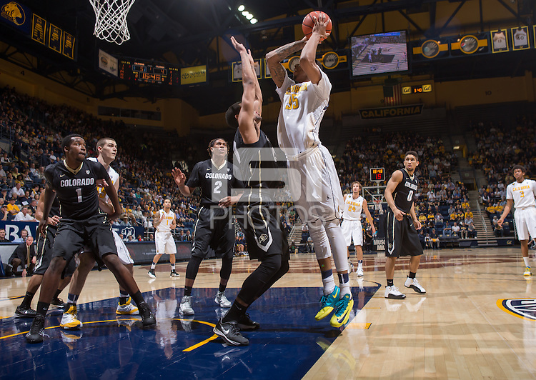 California's Richard Solomon shoots over Colorado defender for the basket during a game at Haas Pavilion in Berkeley, California on March 8th, 2014. California defeated Colorado 66 - 65