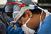 58 year old heart surgeon, Dr. Devi Prasad Shetty conducts an open heart surgery at the Narayana Hrudayalaya in Bangalore, Karnataka, India. Photo: Sanjit Das/Panos