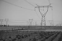 Daytime landscape view of power line towers in an agricultural field near Dàtóng Shì Chéng Qū in Shānxī Province, China  © LAN