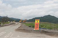 Parked construction vehicles during reconstruction efforts following the 311 Tohoku Tsunami in Rikuzentakata, Japan  © LAN