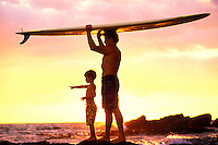 Father and son checking out the waves before surfing