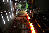 A worker uses a sink next to a production line for H-beams at Ma Steel (Maanshan Iron & Steel Co.) in Maanshan, Anhui Province, China..10 Apr 2006