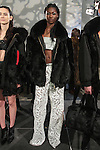 Model Juanita poses in an oversided rabbit for bomber with fox collar, silver velvet bandeau, and white tulle/leather wide leg pant from the Adrienne Landau Fall Winter 2016 collection, presented on February 17 2016, during New York Fashion Week Fall 2016.