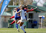 BROOKINGS, SD - OCTOBER 9:  Shelby Raper #4 from South Dakota State University (in blue) nudges the ball past keeper Ryliegh Bohnenstiehl #1 and defender Kelli Keller #22 from Oral Roberts for a goal during their game Sunday afternoon at Fischback Park in Brookings. (Photo by Dave Eggen/Inertia)