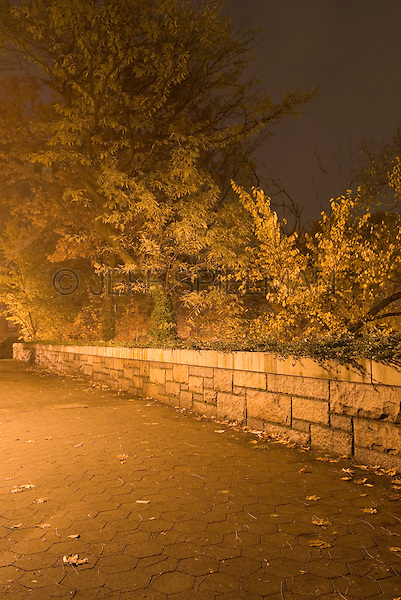 Path, Stone Wall, Trees and Shrubs Illuminated on an Autumn Night....Brooklyn Heights, Brooklyn, New York City, New York State, USA