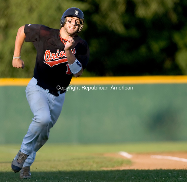 WATERBURY, CT- 31 JULY 2007- 073107JT06- <br /> Oakville's Tommy Piacenza runs towards home to score the team's third run during Tuesday's American Legion Zone 5 play-in final against Monroe at Municipal Stadium in Waterbury. Oakville lost 4-8.<br /> Josalee Thrift / Republican-American