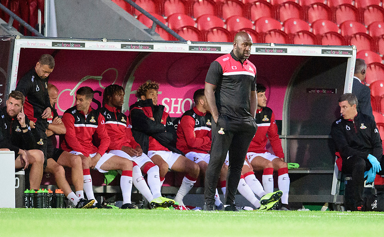 Doncaster Rovers manager Darren Moore in his dug out<br /> <br /> Photographer Andrew Vaughan/CameraSport<br /> <br /> EFL Leasing.com Trophy - Northern Section - Group H - Doncaster Rovers v Lincoln City - Tuesday 3rd September 2019 - Keepmoat Stadium - Doncaster<br />  <br /> World Copyright © 2018 CameraSport. All rights reserved. 43 Linden Ave. Countesthorpe. Leicester. England. LE8 5PG - Tel: +44 (0) 116 277 4147 - admin@camerasport.com - www.camerasport.com