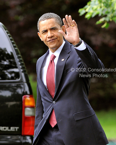 Washington, D.C. - May 17, 2009 -- United States President Barack Obama waves to the photographers as he walks from the Oval Office to Marine 1 on the South Lawn of the White House in Washington, D.C. on Sunday, May 17, 2009.  The President is scheduled to deliver the commencement address at Notre Dame University in South Bend, Indiana and a Democratic Fund raiser in Indianapolis, Indiana before returning to Washington in the evening..Credit: Ron Sachs / CNP