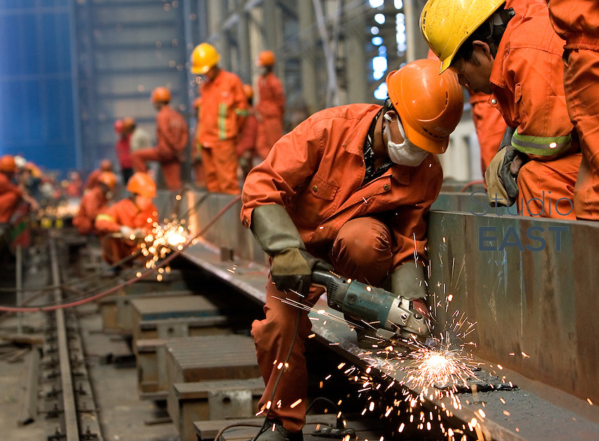 Workers weld steel in the workshops of a factory on Changxing Island, near Shanghai, on October 13, 2008. Baosteel, China's biggest steel producer, is to take over Ningbo Iron and Steel Group and Baotou Iron and Steel Group. The Chinese government is encouraging mergers in order to restructure the steel industry, according to the steel industry stimulus plan approved by the State Council in January. Photo by Servais Mont/Pictobank