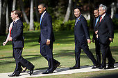 United States President Barack Obama and world leaders walk to participate in the Asia-Pacific Economic Cooperation (APEC) family photo session at the J.W. Marriott Hotel in Honolulu, Hawaii on Sunday, November 13, 2011. From left Prime Minister Julie Gillard of Australia, President Dmitry Medvedev of Russia, President Obama, Prime Minister Yoshihiko Noda of Japan , Sultan of Brunei Hassanal Bolkiah, and President Sebastián Piñera of Chile. .Credit: Kent Nishimura / Pool via CNP