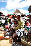 A mother holds a baby at the Analakely market in Antananarivo in Madagascar