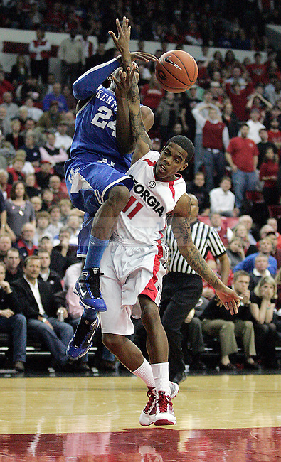 Freshman guard Eric Bledsoe gets tangled up in Vincent Williams while trying to make a lay up in the second half of UK's 80-68 win over Georgia at Stegeman Coliseum  in Athens, GA on Wednesday, March 3, 2010. Photo by Britney McIntosh | Staff