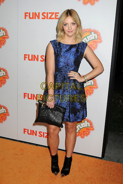 "Abby Elliott.""Fun Size"" Los Angeles Premiere held at Paramount Studios, Los Angeles, California, USA..October 25th, 2012.full length dress sleeveless hand on hip clutch bag ankle boots black blue pattern print.CAP/ADM/BP.©Byron Purvis/AdMedia/Capital Pictures."