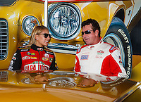 Sep 2, 2016; Clermont, IN, USA; Papa Johns pizza founder John Schnatter (right) talks with NHRA top fuel driver Leah Pritchett during qualifying for the US Nationals at Lucas Oil Raceway. Mandatory Credit: Mark J. Rebilas-USA TODAY Sports