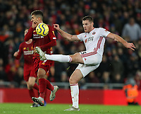 2nd January 2020; Anfield, Liverpool, Merseyside, England; English Premier League Football, Liverpool versus Sheffield United; Jack O'Connell of Sheffield United makes a clearance as Roberto Firmino of Liverpool attempts to block - Strictly Editorial Use Only. No use with unauthorized audio, video, data, fixture lists, club/league logos or 'live' services. Online in-match use limited to 120 images, no video emulation. No use in betting, games or single club/league/player publications