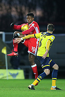 Chuks Aneke of MK Dons controls the ball as Oxford United's Aaron Martin looks on during Oxford United vs MK Dons, Sky Bet EFL League 1 Football at the Kassam Stadium on 1st January 2018