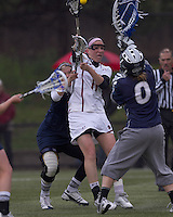Boston College midfielder Brittany Wilton (11) in front of the net. Boston College defeated University of New Hampshire, 11-6, at Newton Campus Field, May 1, 2012.