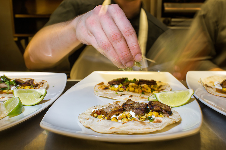 Raleigh, North Carolina - Thursday January 28, 2016 - Ciantro is sprinkled on the tacos being served on the 18 Seaboard's restaurant week menu at the location in Raleigh.