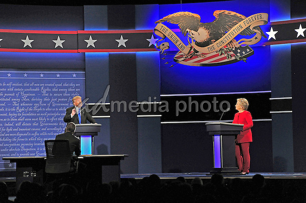 Former United States Secretary of State Hillary Clinton, the Democratic Party nominee for President of the US and businessman Donald J. Trump, the Republican Party nominee for President of the US, appear in the first of three presidential general election debates at Hofstra University in Hempstead, New York on Monday, September 26, 2016. Photo Credit: Ron Sachs/CNP/AdMedia