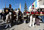 A Palestinian bagpipe band parades during the Orthodox Christmas celebrations at the Church of the Nativity, in the West Bank town of Bethlehem, 06 January 2019. The Church of the Nativity, built on the site where Jesus Christ is believed to have been born in the West Bank city of Bethlehem, is administered jointly by Greek Orthodox, Roman Catholic, Armenian Apostolic, and Syriac Orthodox church. Orthodox believers celebrate Christmas Day on 07 January, according to the Julian calendar. Photo by Wisam Hashlamoun