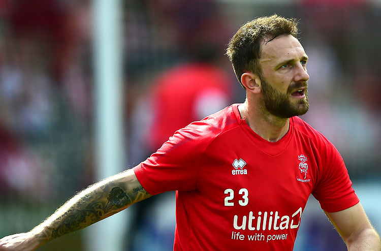 Lincoln City's Neal Eardley during the pre-match warm-up<br /> <br /> Photographer Andrew Vaughan/CameraSport<br /> <br /> The EFL Sky Bet League Two - Lincoln City v Tranmere Rovers - Monday 22nd April 2019 - Sincil Bank - Lincoln<br /> <br /> World Copyright © 2019 CameraSport. All rights reserved. 43 Linden Ave. Countesthorpe. Leicester. England. LE8 5PG - Tel: +44 (0) 116 277 4147 - admin@camerasport.com - www.camerasport.com