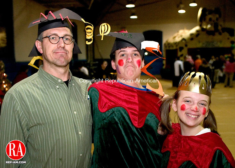 TORRINGTON, CT - 31 December 2004 - 123104TH06 - Torrington High School art teacher, Victor Leger, and members of the Torrington Parks and Recreation Department, Daniel Hanusch, 15, and Kelsey LaMagdeleine, 17, both of Torrington High School, pose during the Last Night celebration put on by the Torrington Parks and Recreation Department New Year's Eve at the Torrington Armory on South Main Street.  Todd Hougas Photo