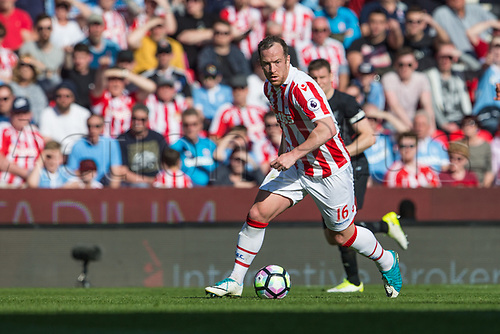 April 8th 2017, bet365 Stadium, Stoke on Trent, Staffordshire, England; EPL Premier League football, Stoke City versus Liverpool; Stoke City's Charlie Adam chases down a loose ball