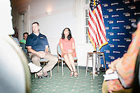"""Supriya Jolly Jindal watches as her husband Louisiana governor and Republican presidential candidate Bobby Jindal speaks to people gathered at his """"Believe Again"""" campaign event at the Governor's Inn and Restaurant in Rochester, New Hampshire. Jindal is campaigning in New Hampshire in advance of the 2016 Republican presidential primary there."""