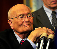 United States Representative John Dingell (Democrat of Michigan) looks on as his fellow House Democratic Leaders celebrate the passage of the health care reform bill in the U.S. Capitol in Washington, D.C. early Monday morning, March 22, 2010. Credit: Ron Sachs/CNP/AdMedia