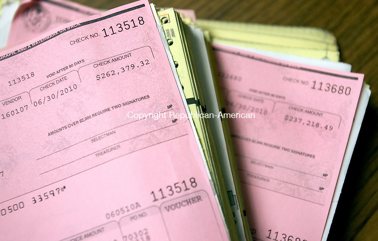 SOUTHBURY, CT. 14 December 2010-121410SV03--Copys of  checks on file for over $200,000 written to O&amp;G Industries at the treasures office in Town Hall in Southbury Tuesday. Southbury's largest single expense (besides personnel) is for paving asphalt. <br /> Steven Valenti Republican-American
