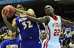 Winston-Salem Prep's Coye Simmons (22) fights for a rebound with Plymouth's Stephaun Lesesne (32) during the Phoenix' 61-49 win in the State Championship at the Dean Smith Center in Chapel Hill, NC, on Saturday, March 10, 2012.  Photo by Ted Richardson