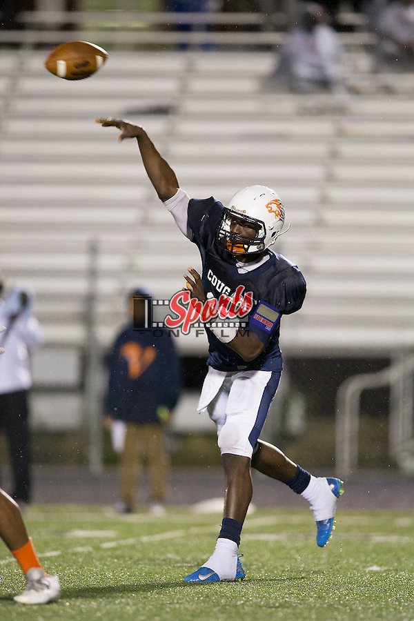 Kingsley Ifedi (12) of the Vance Cougars passes the football during second half action against the A.L. Brown Wonders at Rocky River High School on October 5, 2015 in Charlotte, North Carolina.  The Wonders defeated the Cougars 31-14.  (Brian Westerholt/Sports On Film)