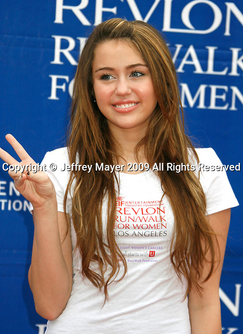 LOS ANGELES, CA. - May 09: Miley Cyrus arrives at the 16th Annual EIF Revlon Run/Walk For Women at the Los Angeles Memorial Coliseum on May 9, 2009 in Los Angeles, California.