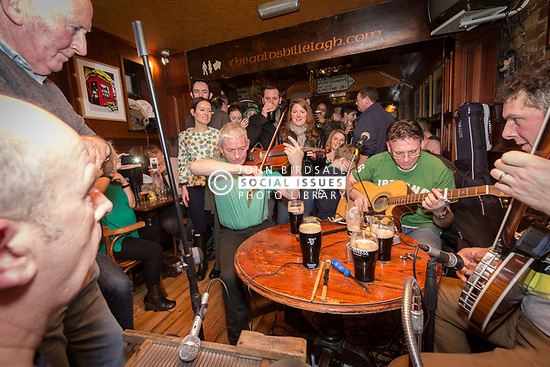 St Patrick's Day celebration in Irish pub, Stoke Newington, London UK 2013