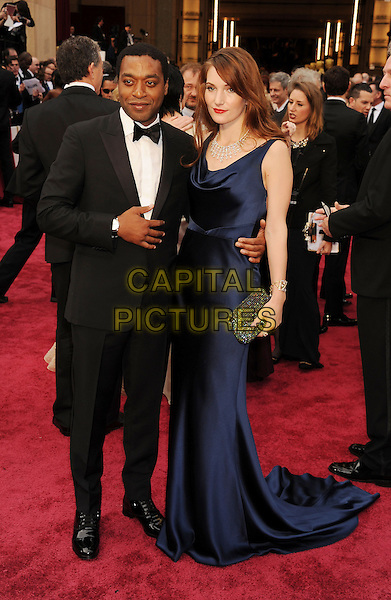 HOLLYWOOD, CA- MARCH 02: Actor Chiwetel Ejiofor (L) and Sari Mercer attend the 86th Annual Academy Awards held at Hollywood &amp; Highland Center on March 2, 2014 in Hollywood, California.<br /> CAP/ROT/TM<br /> &copy;Tony Michaels/Roth Stock/Capital Pictures