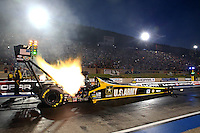 Jul. 18, 2014; Morrison, CO, USA; NHRA top fuel driver Tony Schumacher during qualifying for the Mile High Nationals at Bandimere Speedway. Mandatory Credit: Mark J. Rebilas-