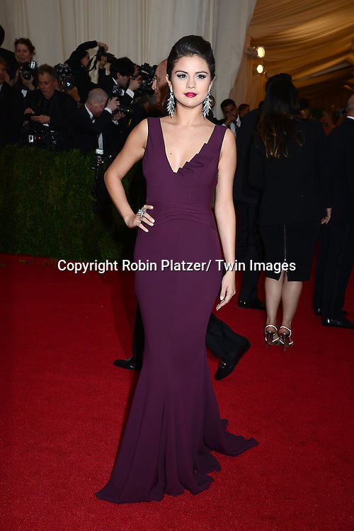 Selena Gomez attends the Costume Institute Benefit on May 5, 2014 at the Metropolitan Museum of Art in New York City, NY, USA. The gala celebrated the opening of Charles James: Beyond Fashion and the new Anna Wintour Costume Center.