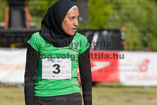 Egypt's Aya Medani (C) crosses the finish line during the Modern Pentathlon Women's World Cup held in Budapest, Hungary on May 07, 2011. ATTILA VOLGYI