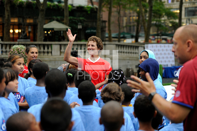Coach Leon Othen introduces National Soccer Hall of Fame member Michelle Akers during a Women's Professional Soccer (WPS) clinic staffed by coaches from UK international Soccer Camps at Bryant Park in New York, NY, on August 25, 2011.