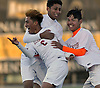 Hernan Cruz #6 of Glen Cove, left, gets mobbed by teammates Ronaldo Velasquez #4, center, and Justin Zapata #20 after scoring his first goal of the season in the 12th minute of the Nassau County Class A varsity boys soccer semifinals against Plainedge at Adelphi University on Friday, Oct. 28, 2016. Glen Cove went on to win 4-0.